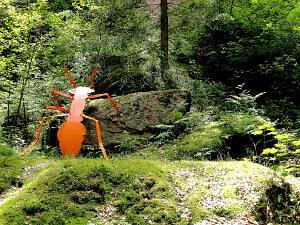 Ein braunes 2D-Modell von einer Ameise.