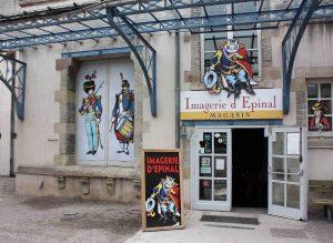 Eingang zum Laden mit dem Verkauf der Kunstdrucke