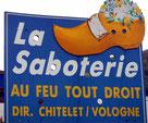 Un panneau indicateur de Saboterie de La Bresse