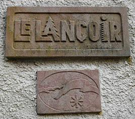 Sign on wall. Lancoir.
