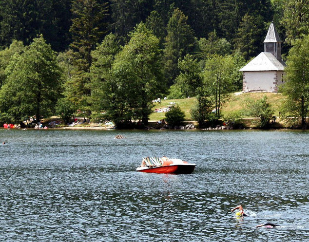 Lake Longemer with the little chapel dedicated to St. Florent.